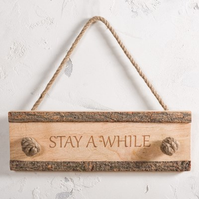 """Stay a While"" Carved Wood Hanging Sign"