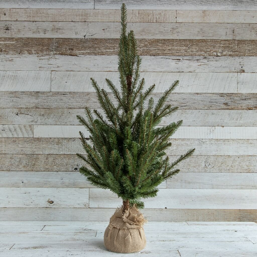 Vintage Christmas tree wrapped in burlap