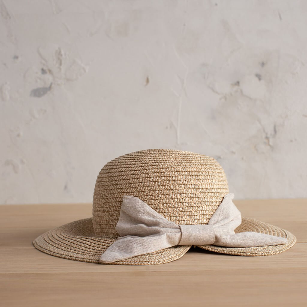 Vintage women's straw hat with cream bow